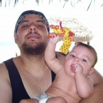 Wael and his daughter at the beach in Panama