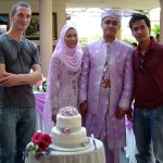 Kuala Lumpur wedding: Bride and groom with the cake. (Editor's note: the fellow on the left is Tom)