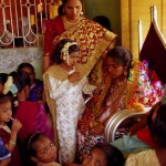 The bride and the women stay in one room while the groom and the men stay in another room ( much bigger ) As seen in the photo the bride is young and appears very solemn, but both were smiling the day after.
