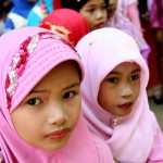 Thai Muslim girls watch a Silat demonstration