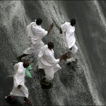 Muslim Hajj pilgrims seek cover following heavy rains