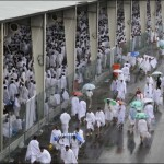 Pilgrims converge on Hajj rain shelters.