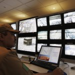 A Saudi policeman monitors screens connected to cameras set up at all holy places in Mina near Mecca, Saudi Arabia, Tuesday, Dec. 9, 2008, during the annual Hajj. (AP Photo/Hassan Ammar)