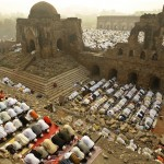 In New Delhi, India, Muslims offer Eid al-Adha prayers at the Ferozshah Kotla Mosque on Tuesday, Dec. 9, 2008. (AP Photo/Gurinder Osan)