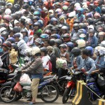 Thousands of motorcyclists are seen waiting to board a ferry taking them to their hometown on Madura Island to celebrate Muslim holiday of Eid al Adha at Tanjung Perak port in Surabaya, Indonesia, Sunday, Dec. 7, 2008. (AP Photo/Trisnadi)