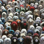 Bangladeshi Muslims offer Eid al-Adha prayers in Dhaka, Bangladesh, Tuesday, Dec. 9, 2008. (AP Photo/Pavel Rahman)