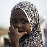 A girl walks home after attending prayers on the first day of the Muslim religious festival of Eid al-Adha at Obanikoro in Lagos, Nigeria on December 8, 2008. (REUTERS/Akintunde Akinleye)