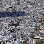Muslim pilgrims pray outside Namira mosque in Arafat near Mecca, Saudi Arabia, Sunday, Dec. 7, 2008. (AP Photo/Hassan Ammar)