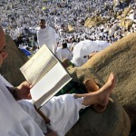 A Muslim pilgrim reads the koran at Mount Arafat, southeast of the Saudi holy city of Mecca, on December 7, 2008. A human tide washed over Mount Arafat today morning as hundreds of thousands of devoted Muslims gathered for the key moment of the annual Hajj pilgrimage to Saudi Arabia. (KHALED DESOUKI/AFP/Getty Images)