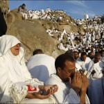Muslim pilgrims pray on a rocky hill called the Mountain of Mercy, on the Plain of Arafat near Mecca, Saudi Arabia, Sunday, Dec. 7. Nearly 3 million pilgrims converged Saturday around the holy city of Mecca at the beginning of the 5-day hajj pilgrimage, a lifelong dream for many Muslims. AP / Hassan Ammar