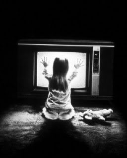 Evil television - little girl in front of a TV