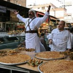A seller of traditional Syrian sweets calls out for customers in the Meidan quarter of Damascus September 2, 2008. Sales of the sweets go up during the Muslim holy month of Ramadan. (REUTERS/Khaled al-Hariri) #