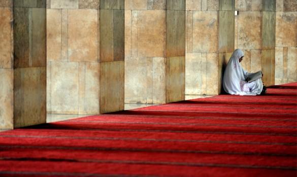 Woman reads Quran