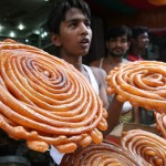 A Bangladeshi vendor sells traditional sweet meats for breaking the Ramadan fast, at the Chalk bazaar in Dhaka, Bangladesh, Friday, Sept. 12, 2008. (AP Photo/Pavel Rahman) #