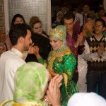 Everyone enjoys the party as bride and groom dance.