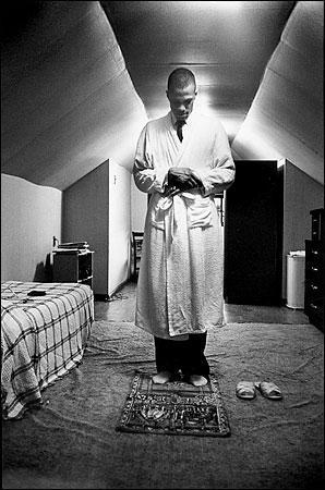 Malcolm X, aka El-Hajj Malik El-Shabazz, standing in prayer