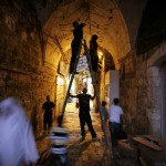 Palestinians decorate an alley for Ramadan