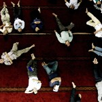 Jakarta, Indonesia: Men rest after prayer on the second day of the month of Ramadan.