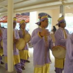 Kompang musicians playing Malay hand drums