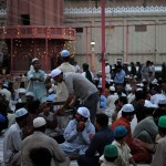 Men distrubute iftar food during Ramadan in Karachi