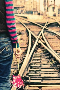 confused girl at train tracks by sinademiral 199x300 %photo