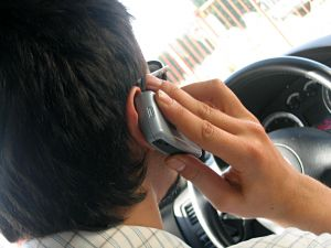 man talking on cell phone driving %photo