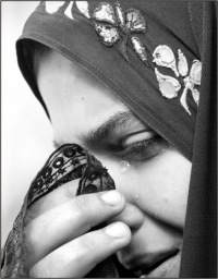 crying muslim woman %photo