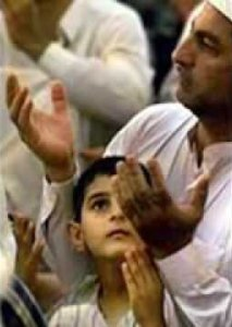 boy and father saying dua %photo
