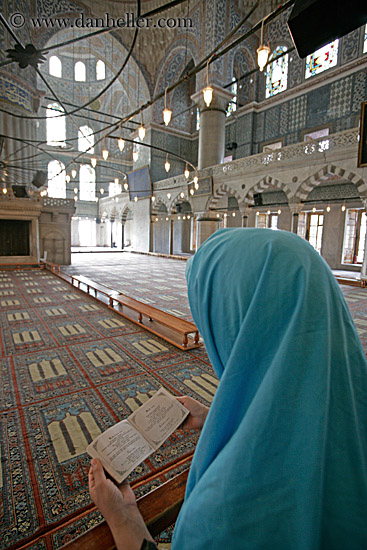 Muslim woman praying at the Blue Mosque in Turkey