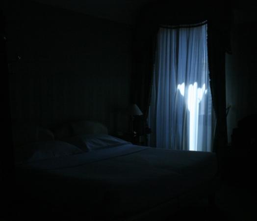 gallery for a dark room with a bed
