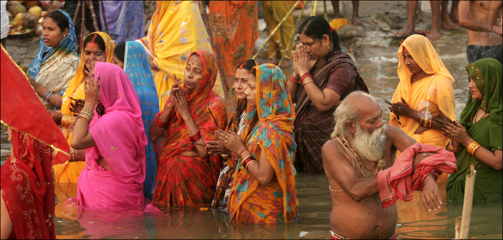 hindu women praying in river %photo