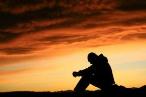 sad man sitting thinking