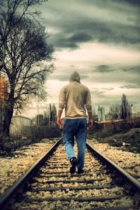 Lonely man walking away.