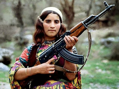 A traditional female Peshmerga fighter