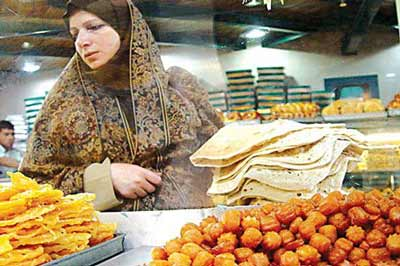 Woman shops for Ramadan meal