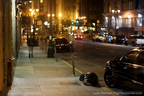 A drunk man passed out on the sidewalk in San Francisco.