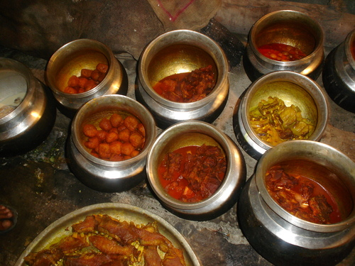 Several Kashmiri wazwan dishes being prepared