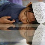 Muslim boy sleeps in a mosque