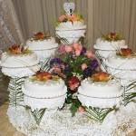 The wedding cake is actually seven cakes around a centerpiece