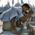 Rawalpindi, Pakistan: A man performs ablution before Friday prayers on the second day of Ramadan. The word Ramadan is derived from an Arabic word meaning intense heat, scorched ground and shortness of rations.