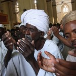 Khartoum, Sudan: Men praying at the main mosque. Every day during the course of Ramadan 1/30th of the Quran is recited, so that by the end of the month the entire book has been completed.