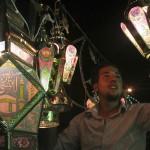 Amman, Jordan: A shopkeeper hangs decorative lights in his store in celebration of Ramadan.
