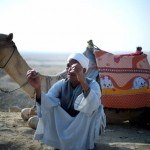 A man with his camel near the Giza pyramids