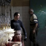 A worker at Amman Municipality Slaughterhouse