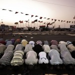 Libyan men praying in Benghazi on the first day of Ramadan 2011.