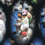 Nepalese Muslims take part in early morning prayers at the Kashmiri Mosque in Kathmandu.