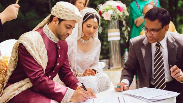 Muslim couple signing the marriage contract.
