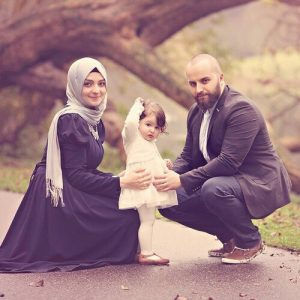 Young Muslim couple and daughter