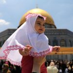 A child in Al-Quds, Palestine.