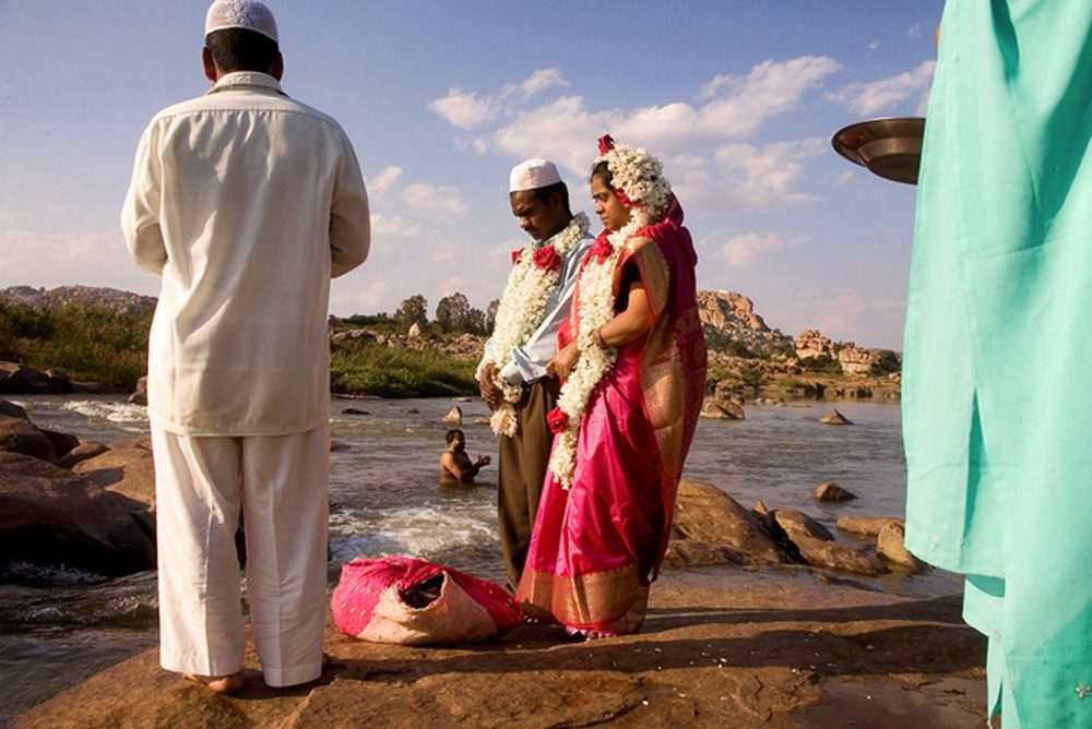 India Muslims get married beside a river